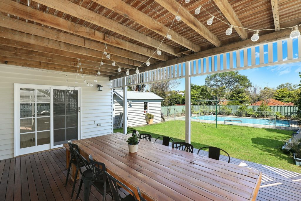 upgraded deck with outdoor furniture and lighting_spring and summer home improvement projects